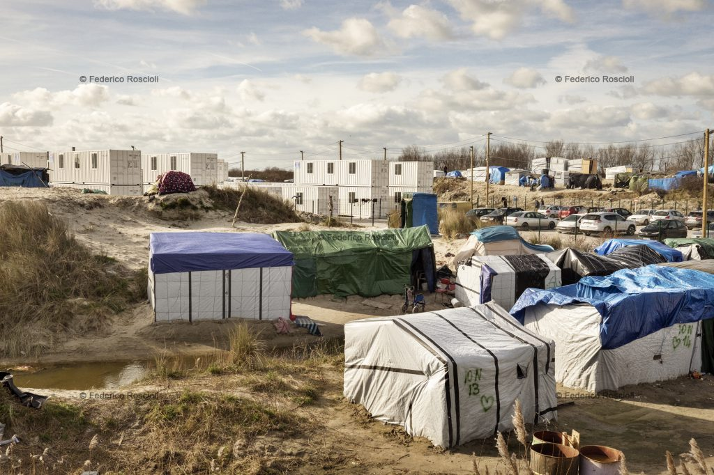 Calais, France. February 28, 2016. The container area inside the camp. This area was built in January 2016, it is accessible only by fingerprints and once in you lose the chance of reaching the UK. The Calais Jungle Camp for migrants, in Calais, France, dates January 2015, it is now the biggest refugee camp in Europe, hosting around 3700 migrants from all over the world. The people hosted in the camp are willing to reach the UK due to the lack of job opportunities in the rest of Europe.