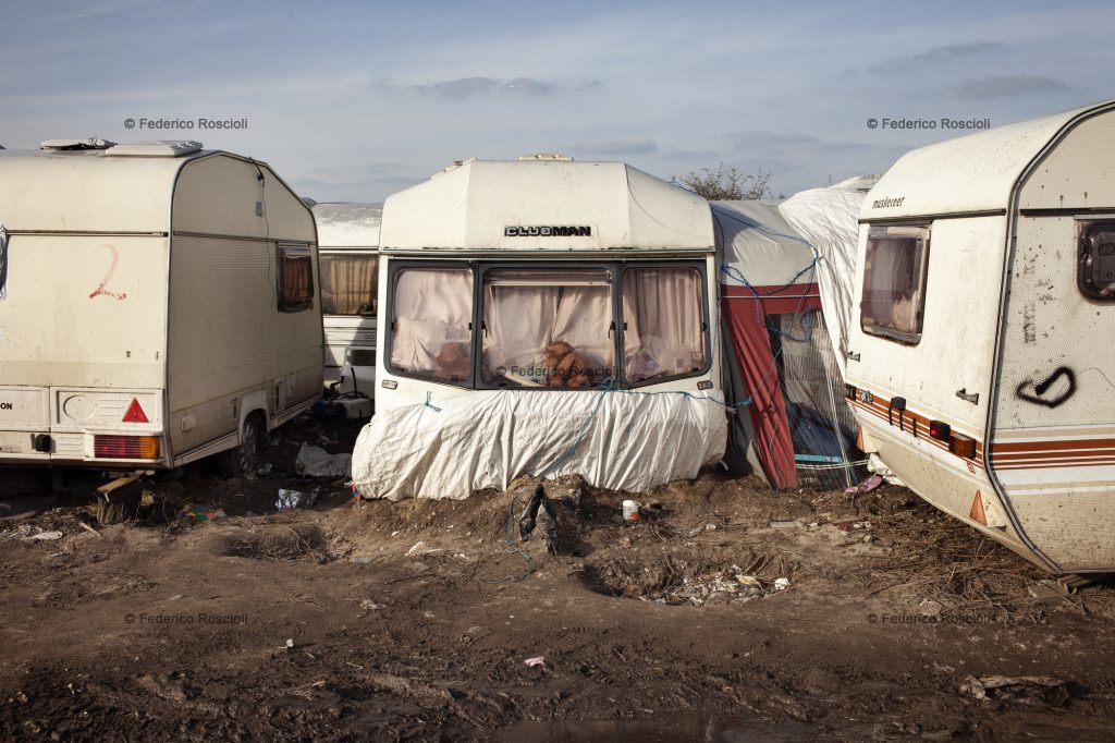 Calais, France. February 27, 2016. Families live in caravans in a specific area fo the camp. There are around 300 families hosted. The Calais Jungle Camp for migrants, in Calais, France, dates January 2015, it is now the biggest refugee camp in Europe, hosting around 3700 migrants from all over the world. The people hosted in the camp are willing to reach the UK due to the lack of job opportunities in the rest of Europe.