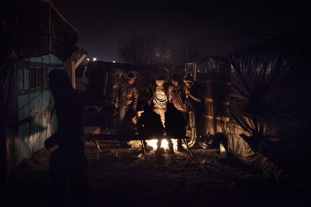 Calais, France. February 27, 2016. Night life inside the camp. The Calais Jungle Camp for migrants, in Calais, France, dates January 2015, it is now the biggest refugee camp in Europe, hosting around 3700 migrants from all over the world. The people hosted in the camp are willing to reach the UK due to the lack of job opportunities in the rest of Europe.