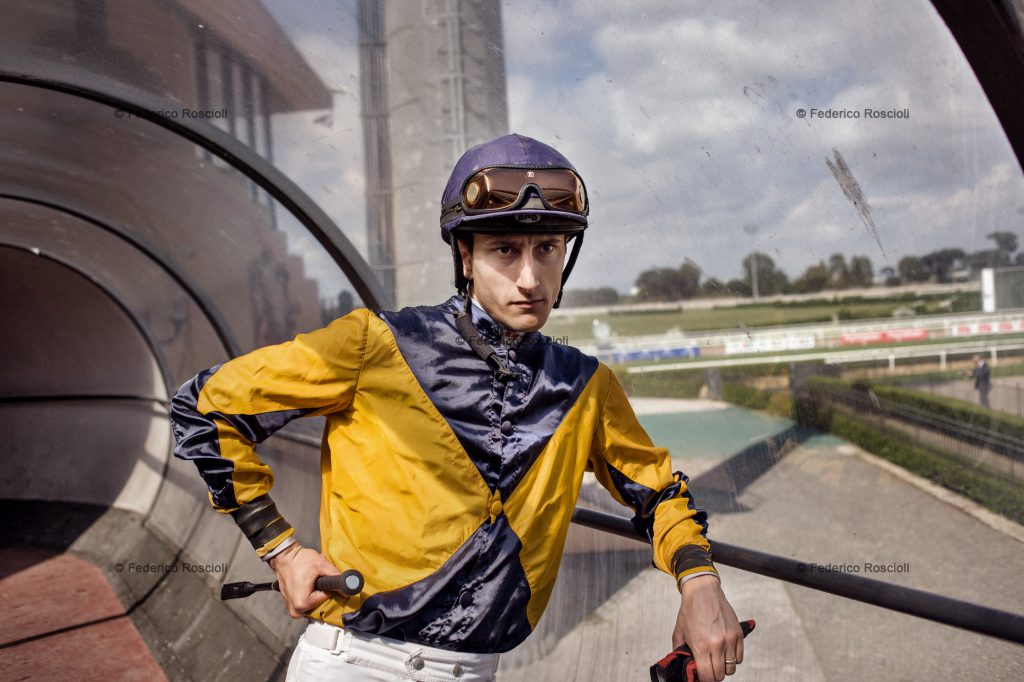 Capannelle, Rome, Italy. May 12, 2013. A jockey before the race on Grand Prix day in honor of the President of the Italian Republic in Capannelle. The jockeys had threatened not to run if the Ministry had not released the payment of arrears belonging to September 2012. ### Capannelle, Roma, Italia. 12 Maggio 2013. Un fantino prima della corsa nel giorno del Gran Premio in onore del Presidente della Repubblica Italiana a Capannelle. I fantini avevano minacciato di non correre se il Ministero non avesse sbloccato il pagamento degli arretrati dovuti dal settembre 2012.