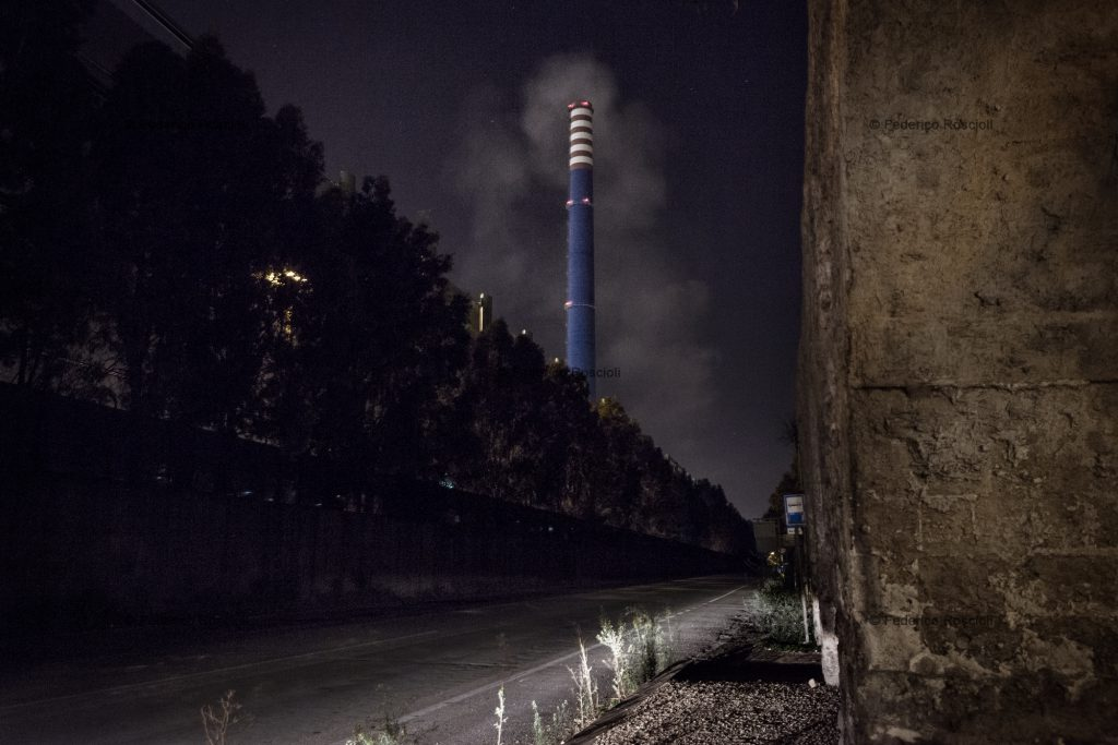 Taranto, Italy, September 26, 2013. Ilva chimney E312 during the night: this is the major suspect for the release of dioxin in the area. There are no certain data due to partial monitoring under progress. It is easy to see how this chimney works heavier during the night than during the day. ### Taranto, Italia, 26 Settembre 2013. Emissioni del camino E312 dell'Ilva durante la notte:  il maggiore indiziato del rilascio di diossina nella zona. Non vi sono, per˜, dati certi, in quanto i monitoraggi fatti sono parziali e tuttora sotto indagine. é evidente ad occhio nudo come le sue emissioni siano maggiori durante la notte e nelle giornate nuvolose.